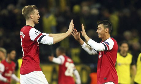 Arsenal's Per Mertesacker, left, and Mesut Ozil